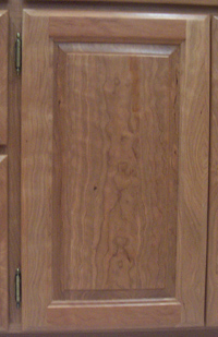 Figured cherry raised panel door